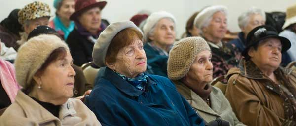 """""""Supportive communities"""" and senior day centers assist Nazi victims remaining in their own homes."""